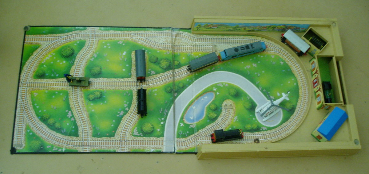 Wellsworth Station Playset- has three different colored roofs for the buildings in which to store the trains.  A blue (shown), red and green roof are included with the set.
