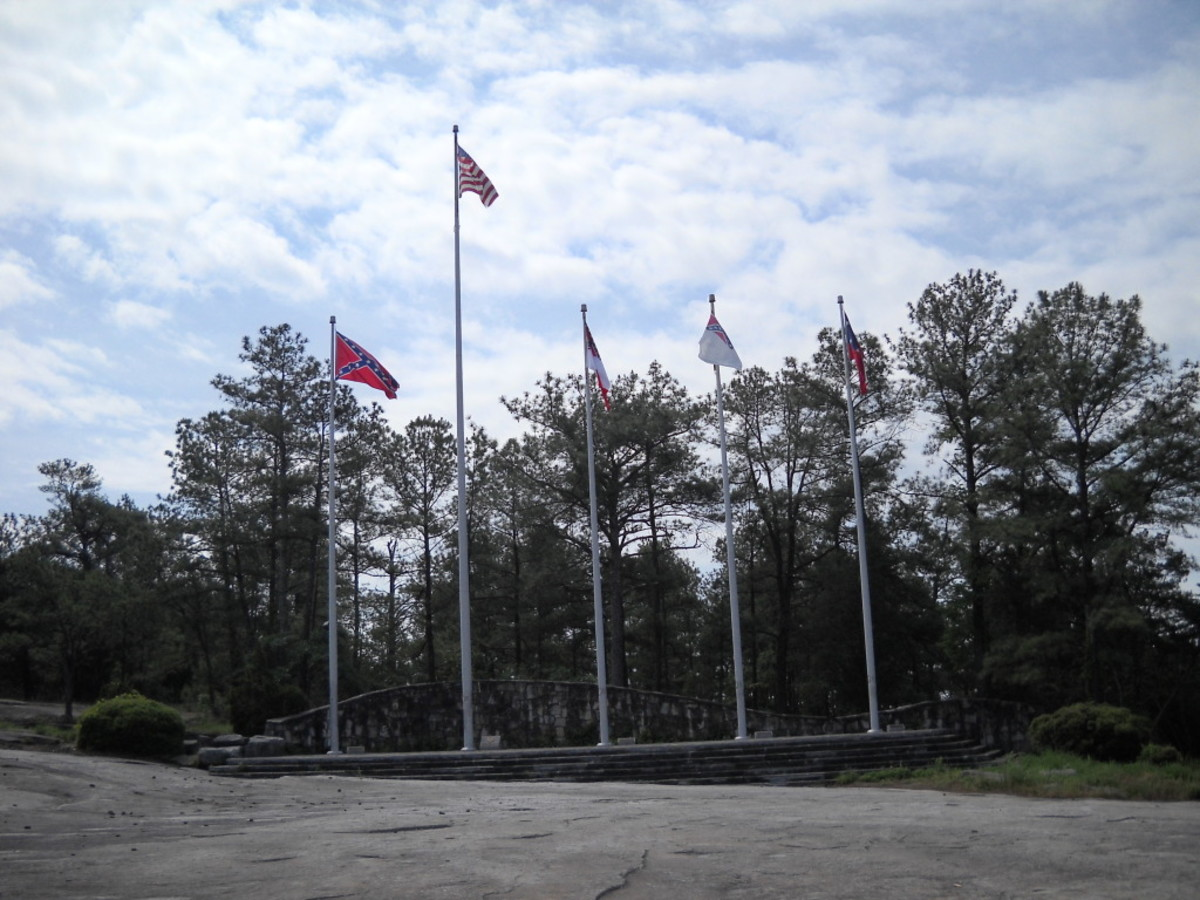 In a line of flags, the American flag must be center and highest.