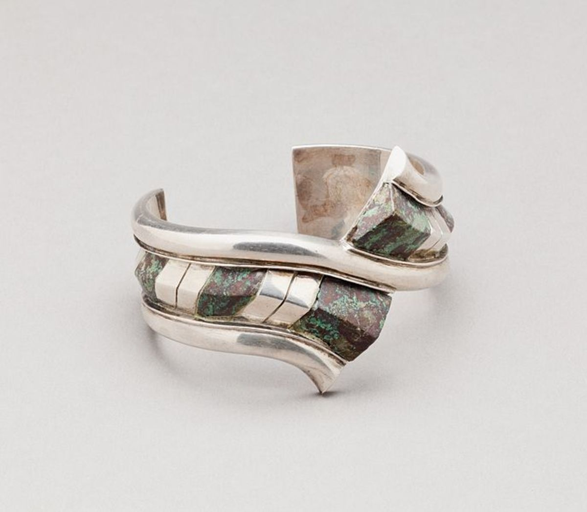 Advanced detail can be achieved with traditional metalsmithing, but it's time-intensive for each piece and can take decades for each artist to perfect.