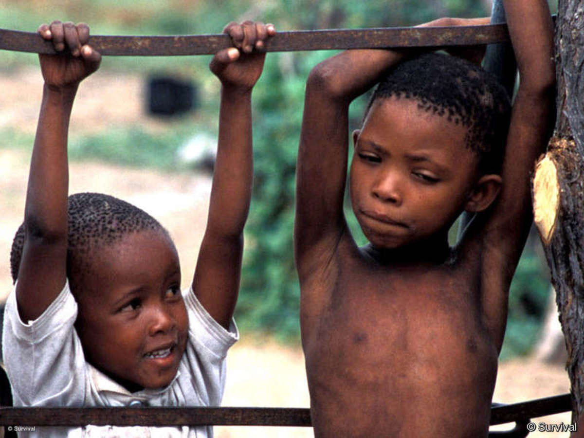 Bushmen children playing, seemingly unaware of the drama surrounding their future.