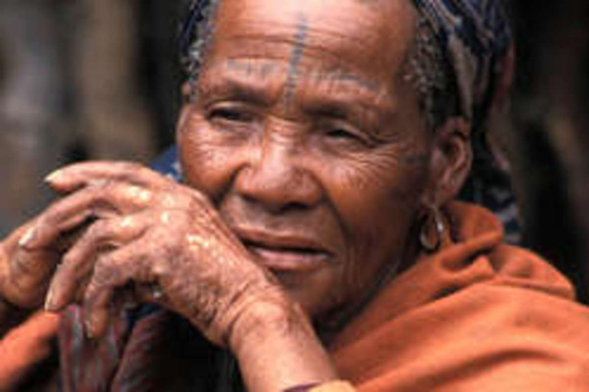Bushman woman contemplates their future.