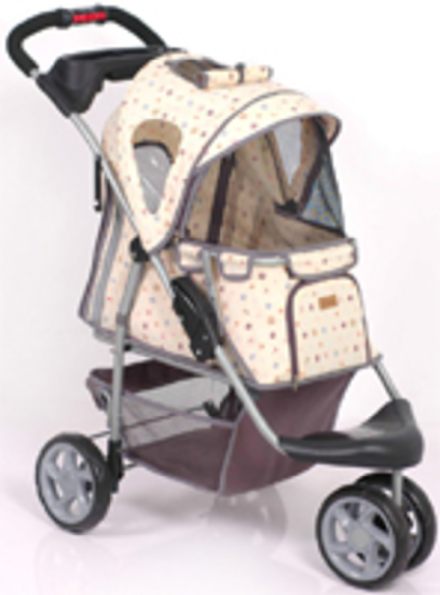Limited Edition jogger stroller with a louie V style monogram with dog bone, bowl and treat pattern, has 3 wheels and fold for easy storage, for pets up to 30 pounds