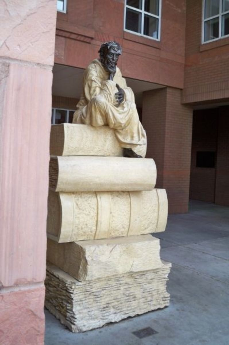 An untitled bronze and limestone sculpture by Peter Parkany, 1996, located outside NAU's Cline Library
