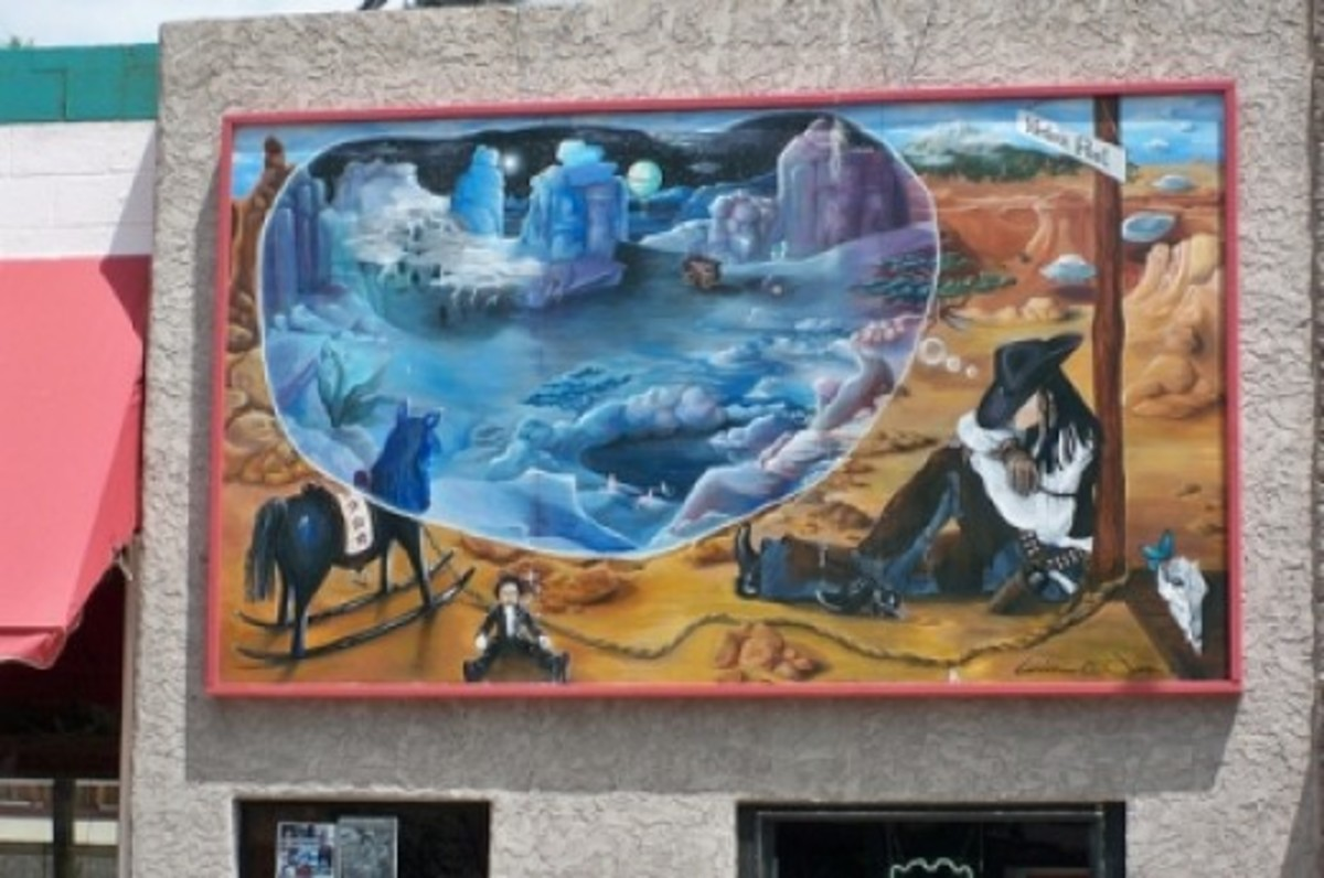 A cowgirl dreams of a faraway fantasy land in this framed mural on San Francisco Street.