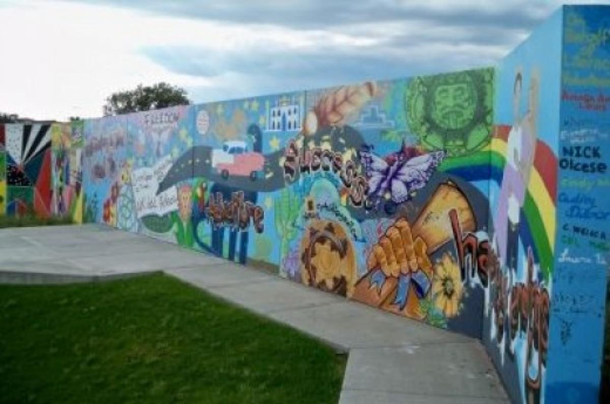 "A mural on behalf of Literacy Volunteers -- ""Reading is the road to freedom, adventure, success, happy endings."""