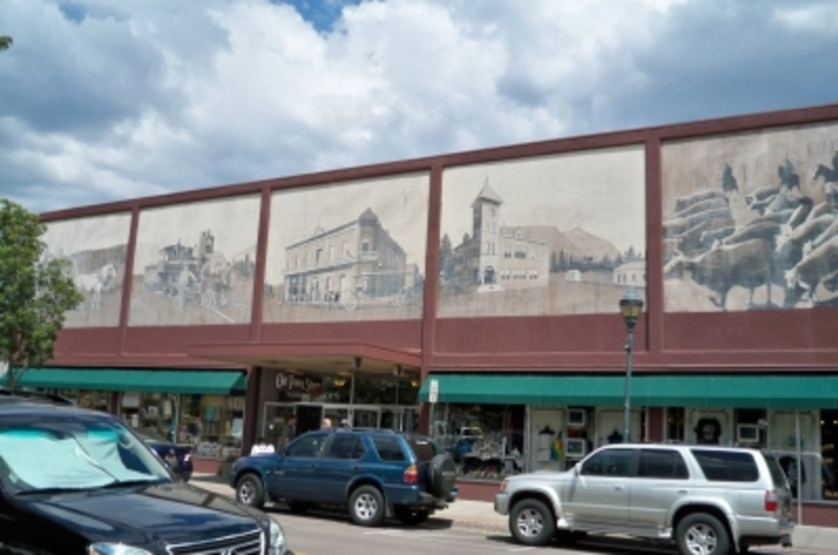 Joe Sorren painted this (fading) series of murals above the Old Town Shoppes, formerly JC Penney.