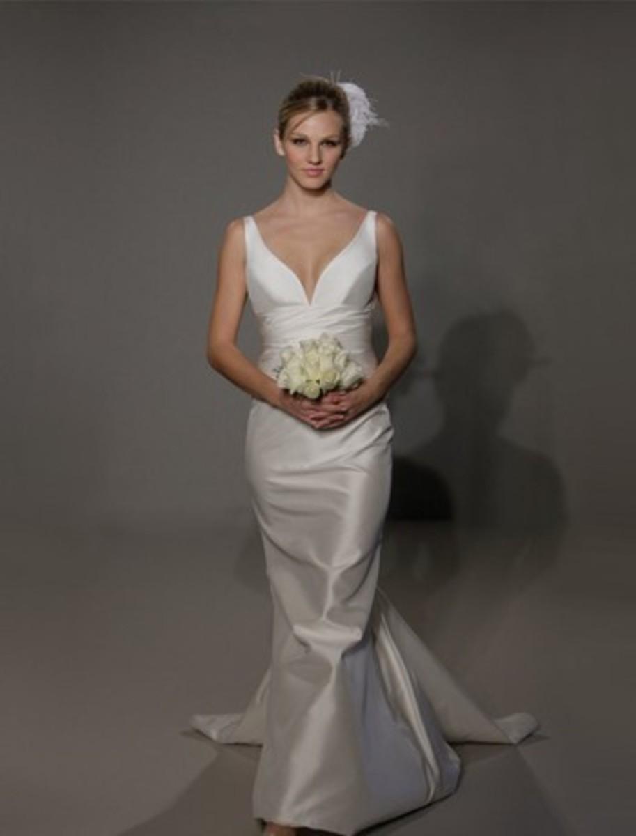Mermaid style, silk taffeta fabric, V neckline sleeveless, cinched waistline.