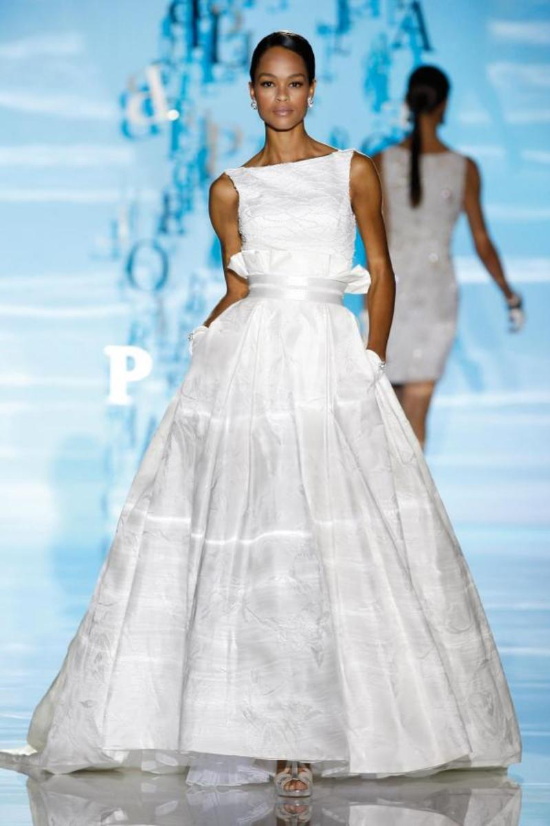 Ruffles replaced with ribbons, boat neckline, belted waistline, full skirt.