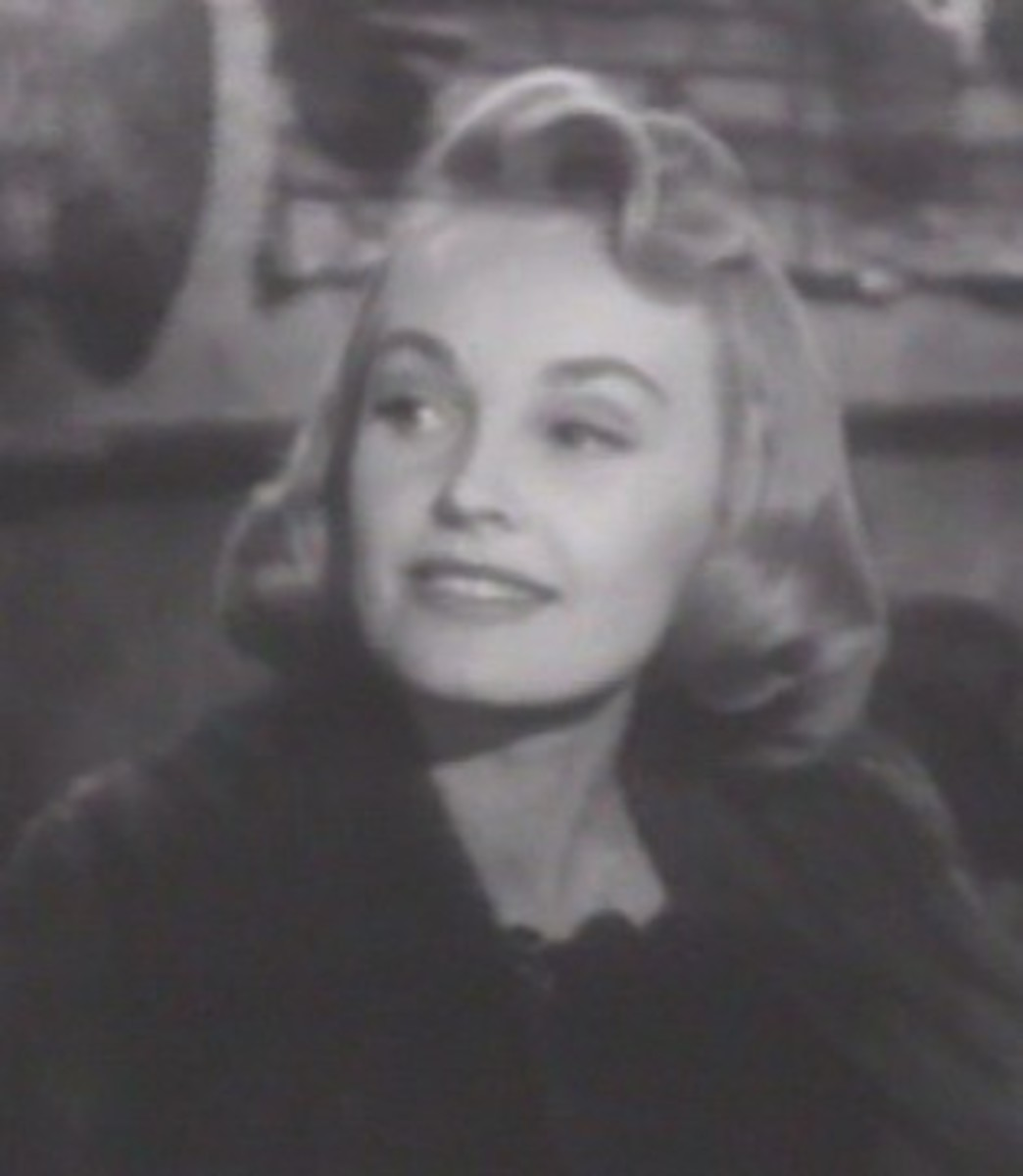 Here's Virginia Lee with hair that ends at her jaw, which would normally be a hair-don't for women with squarish jaws.  But two things save her: the sleek, soft look of the waves and the delicacy of her well-defined features.