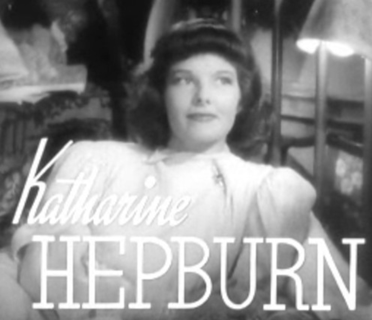 Not the best look for Katharine Hepburn. This 1937 hairstyle is too symmetrical, emphasizing the almost masculine geometry of her face.  The bangs add to the flat top look and shorten her forehead.