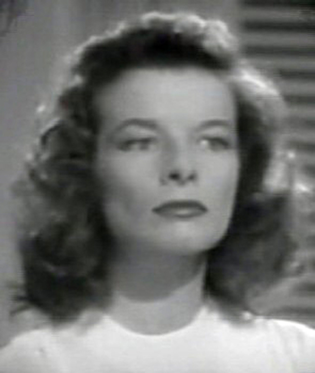 Katharine Hepburn's face still looks square in The Philadelphia Story, but without the bangs, it appears much less squashed.  Her curls round out and soften the top of her head and the angles of her face, ending prettily below the neck.