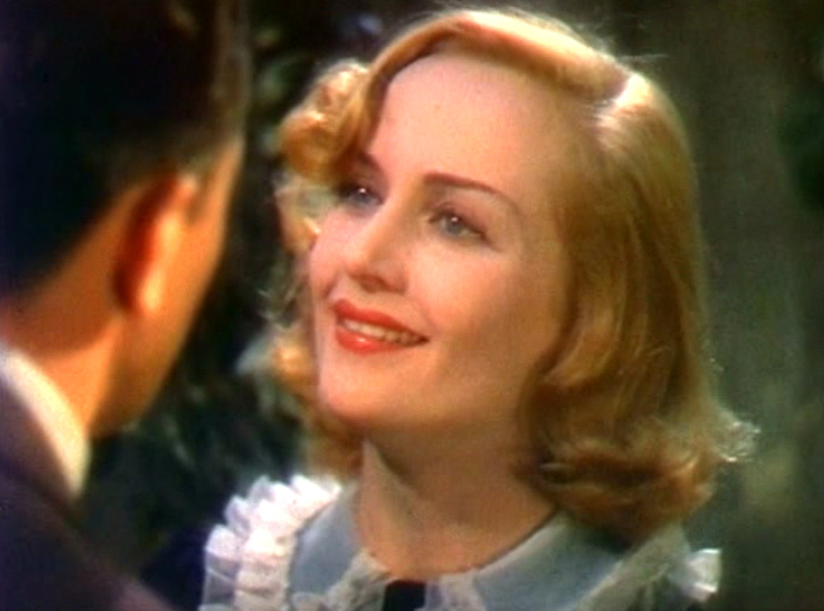 Another rounding off-center part.  Carole Lombard's square jaw was minimized as the stylized waves drew focus to her eyes and below the jawline.