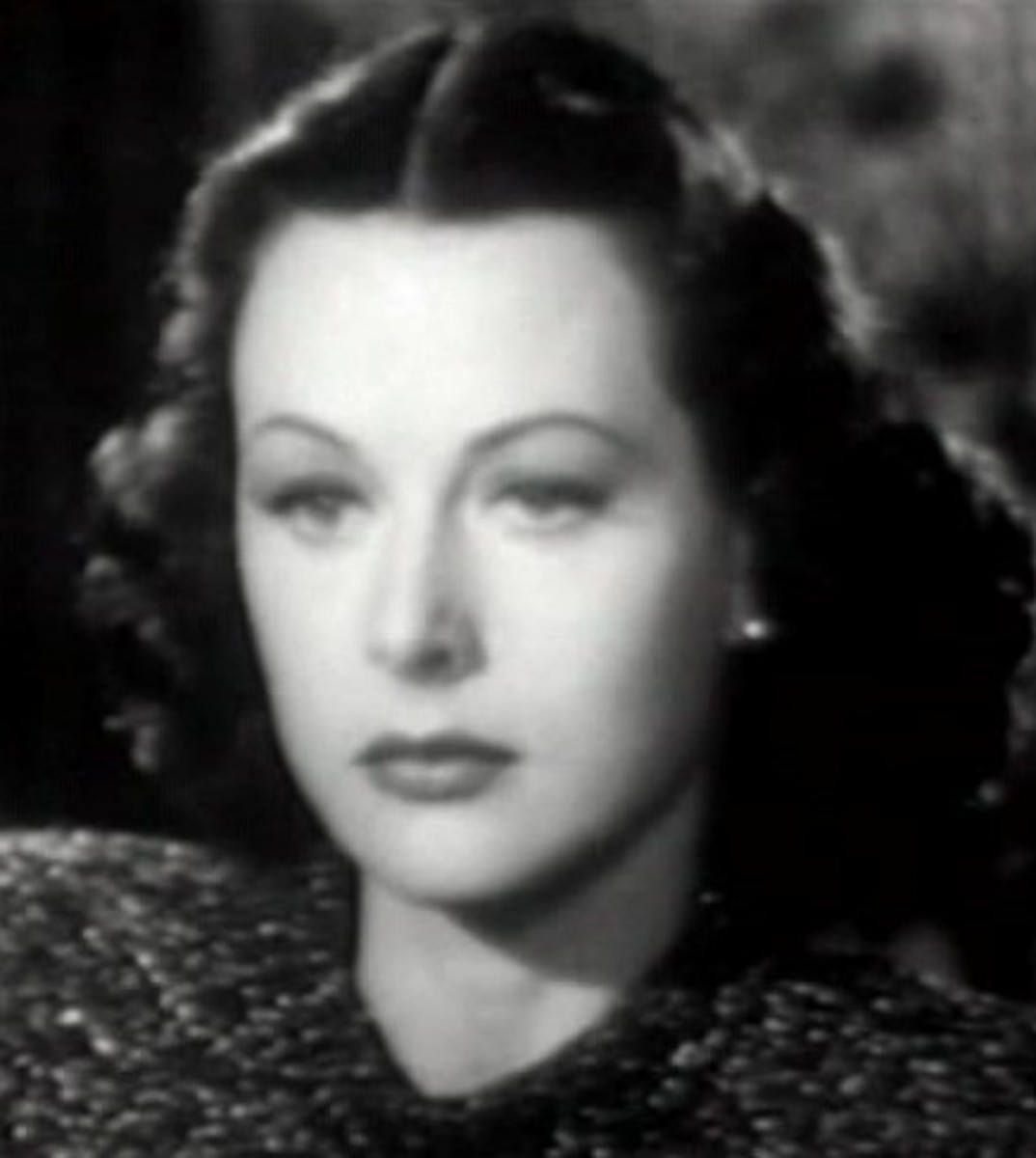 Hedy Lamarr wears a style that broadens at the base of her jaw, rounding out a long thin face shape and making it look more heart-shaped.