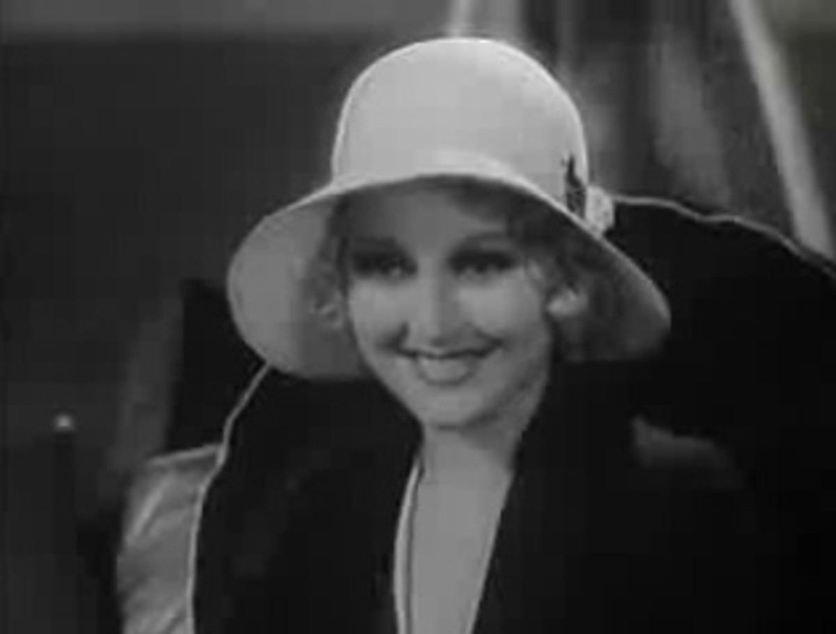 Round face shapes like that of Thelma Todd benefit from minimalistic hairstyles if worn with wide, sweeping hats, which dwarf the face width.