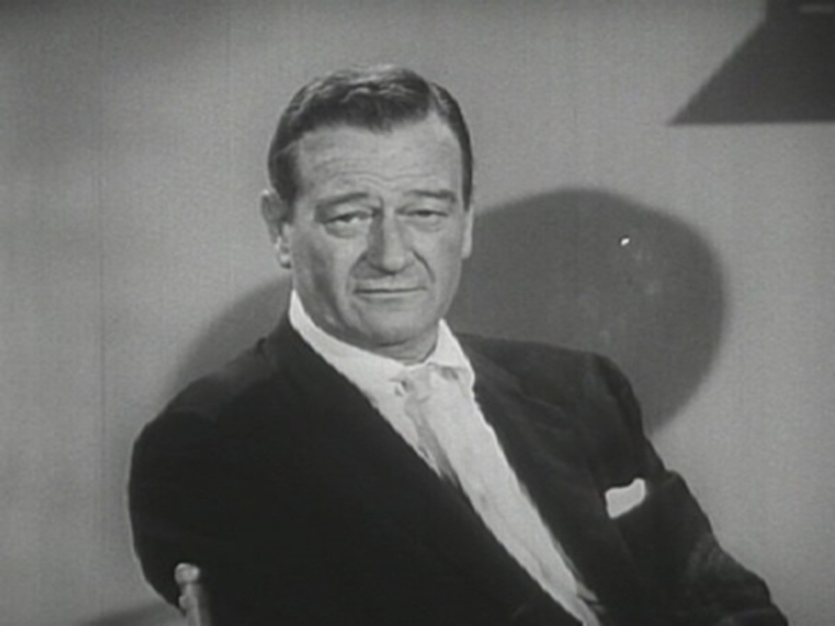 John Wayne's square-shaped face is perfectly acceptable in a guy--in fact, his boxy hairstyle made the most of it.