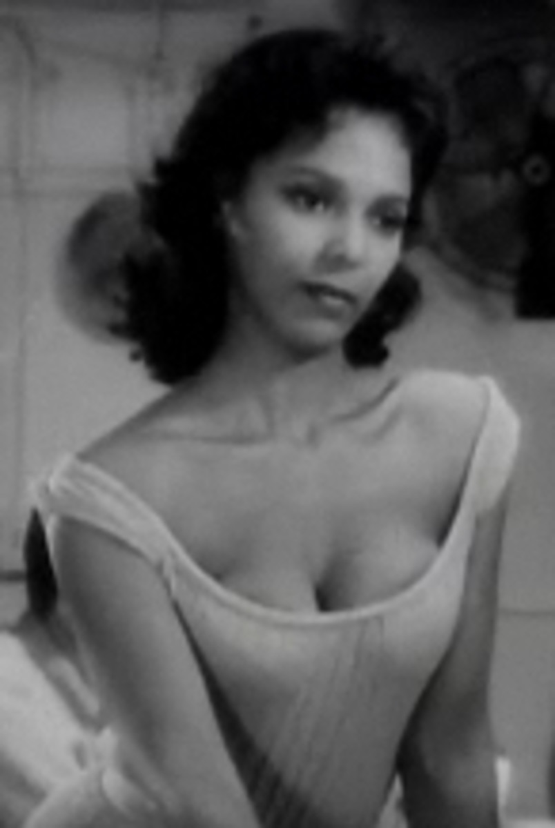 Dorothy Dandridge with a round or heart-shaped face--it's hard to tell--made even more heart-shaped by the fluffing out at her neck.