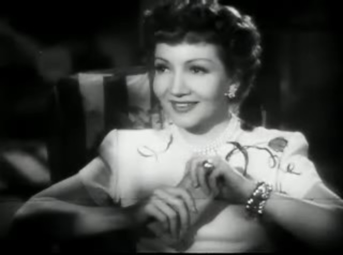 Claudette Colbert's face shape is actually round.  The gentle curls around her skull emphasize the roundness and the softness in The Secret Heart.