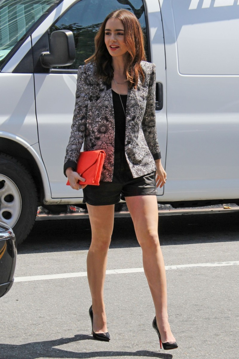Lily Collins elegant street style in a stylish shorts and Louboutin stilettos