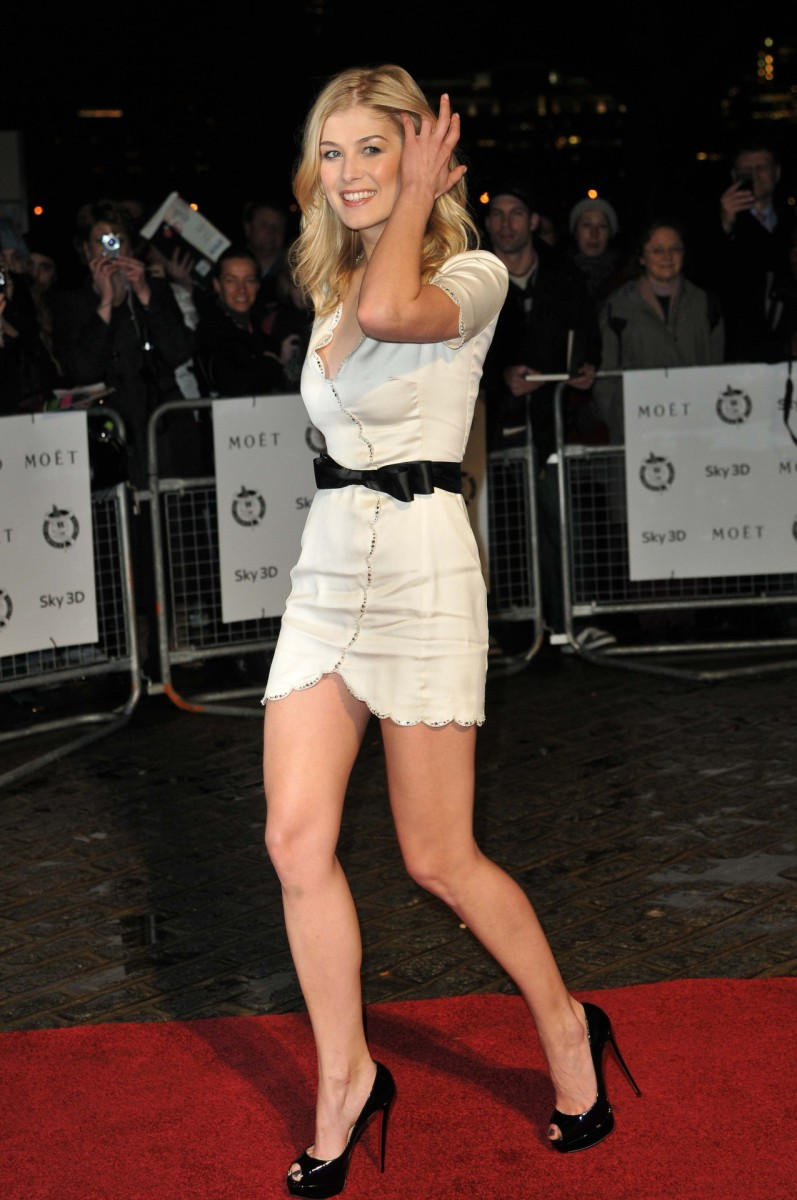 Rosamund Pike leggy in a little white dress and peep toe Louboutin platform pumps