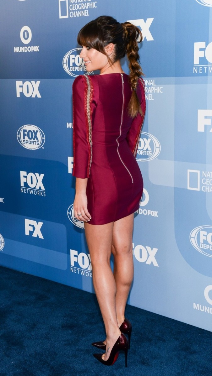 Lea Michele showing off her gorgeous legs in a shiny red mini dress and Louboutin pumps