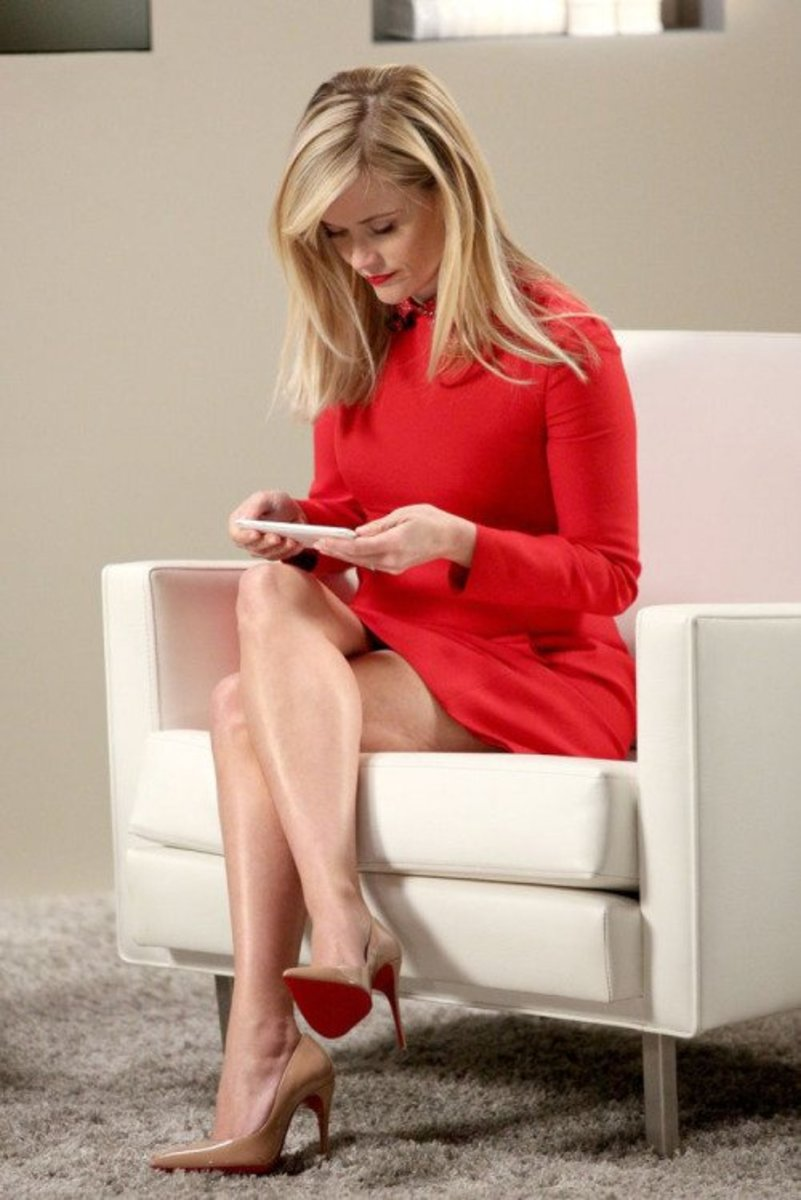 Reese Witherspoon in a short red dress and nude Christian Louboutin high heels