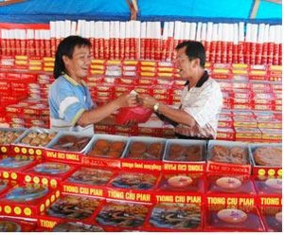Man Selling Moon Cakes in Pontianak, Borneo, Indonesia
