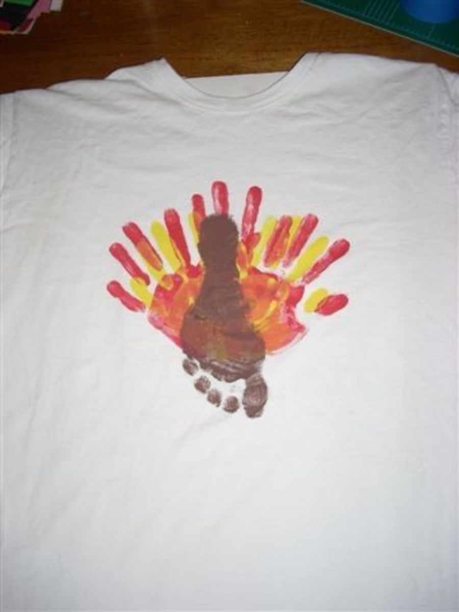 Now repeat procedure with brown paint and child's FOOT. Make sure the heel is up to make the turkey's head. The child's toes will be the turkey's feet. Wash child's foot and let paint dry.