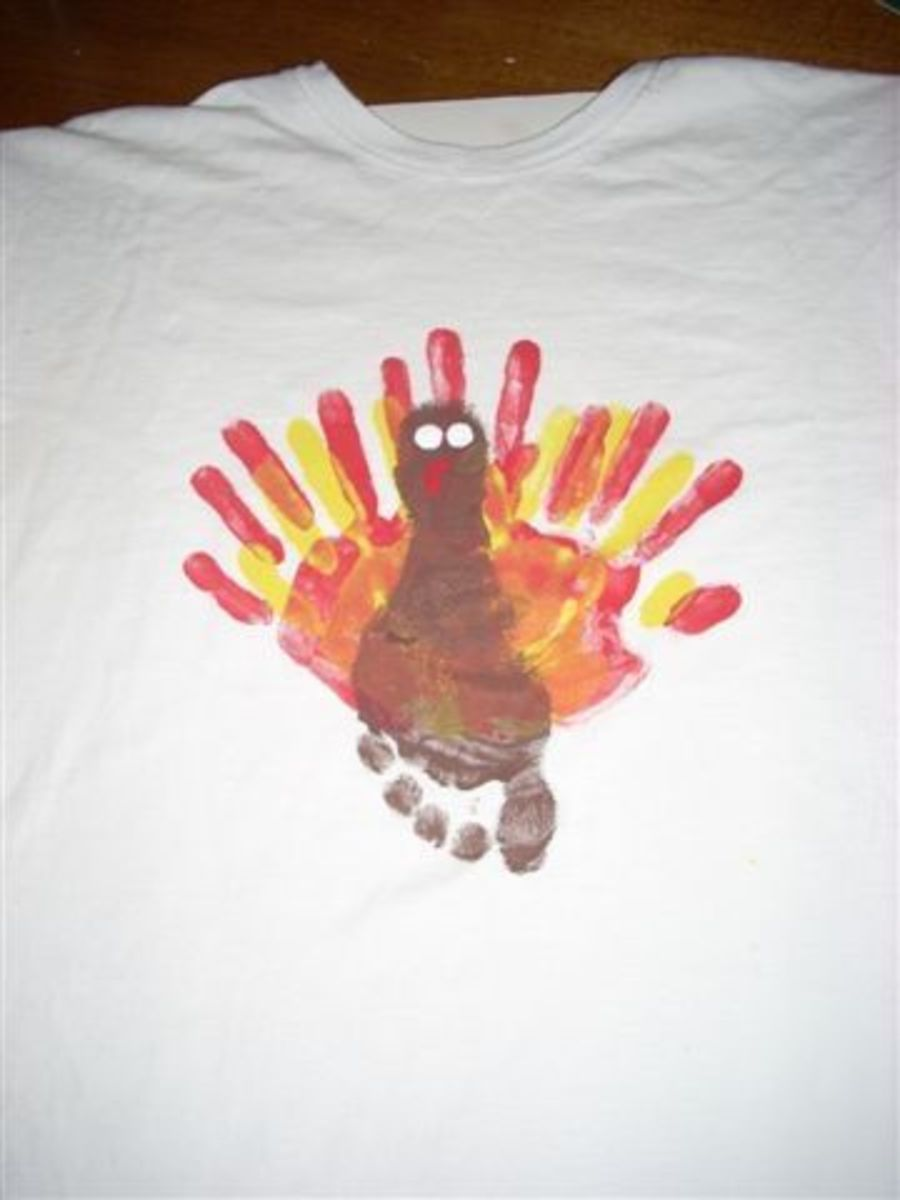 Now paint 2 white circles for the turkey's eyes. And paint a red shape for the waddle. Let paint dry.