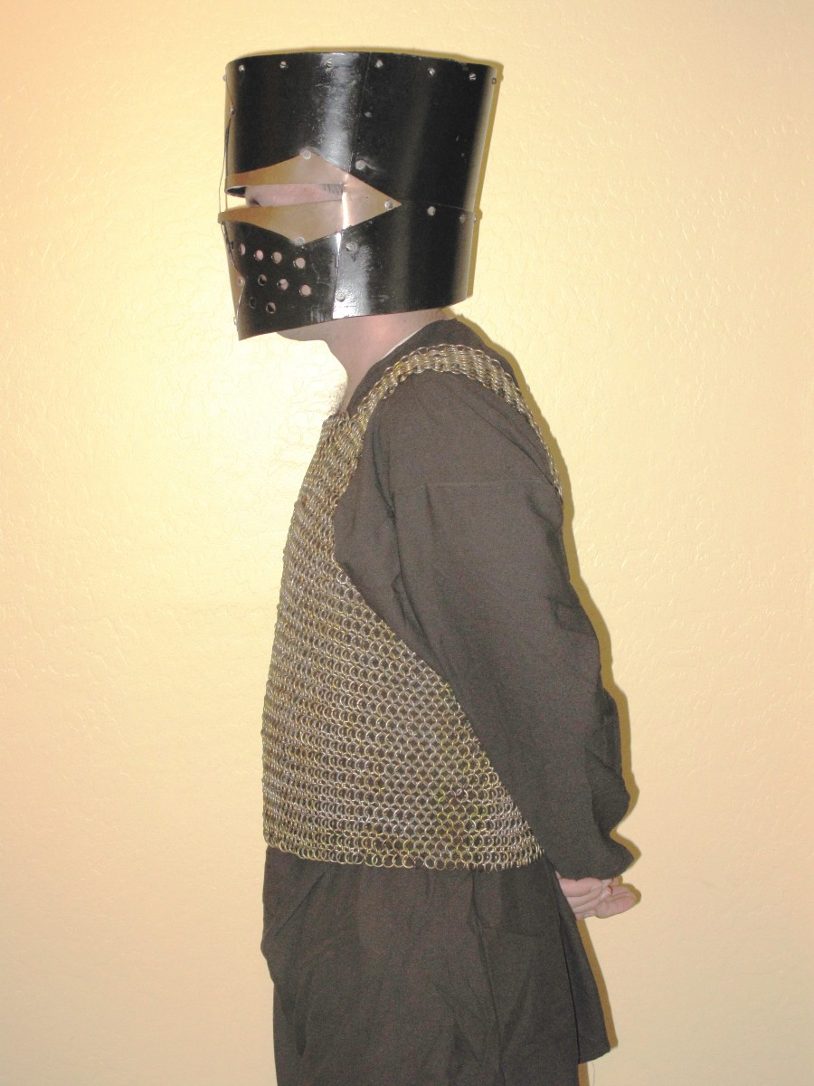 This is the chainmail shirt my husband is working on. It weighs 30 pounds. The helmet weighs about 10 lbs.
