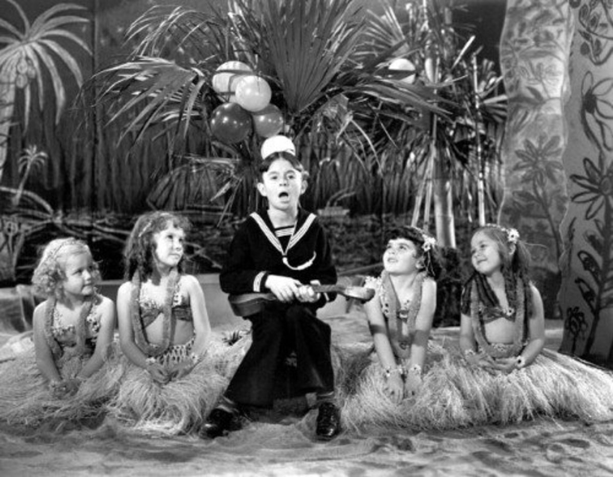 Alfalfa croons while the girls swoon! Darla is pictured second from the right.