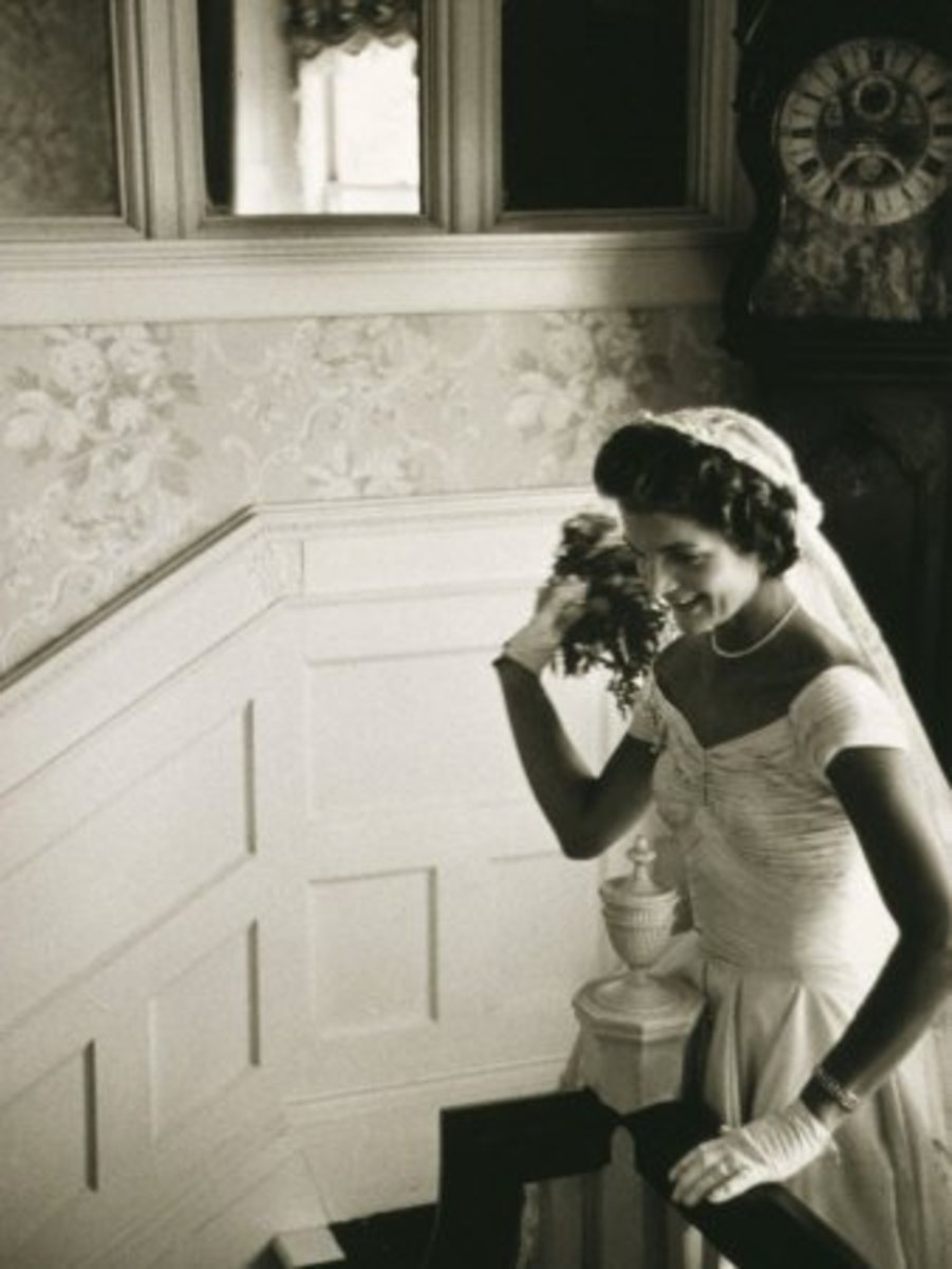Jackie Kennedy throwing her wedding bouquet courtesy of allposters.com