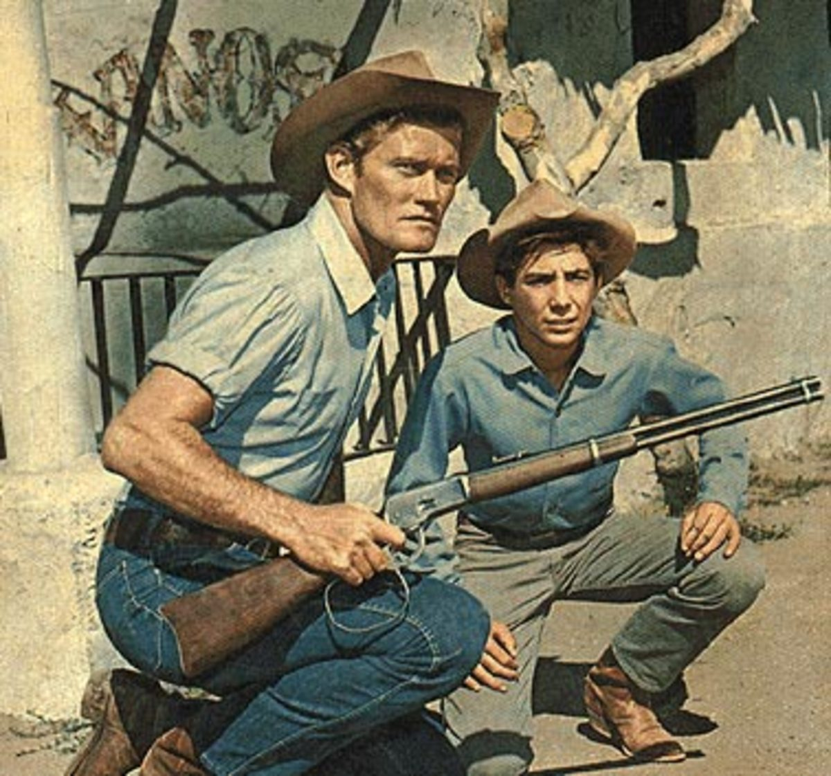 """The Rifleman"" starring Chuck Connors as Lucas McCain with his custom large loop lever Winchester Model 1892 chambered for the black powder .44-40 cartridge with his son, Mark."