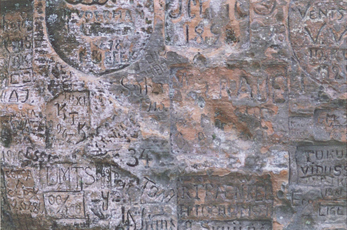 Ancient graffiti on a cave wall near Sigulda in Latvia. Photo by mrlederhosen @ flickr.com.