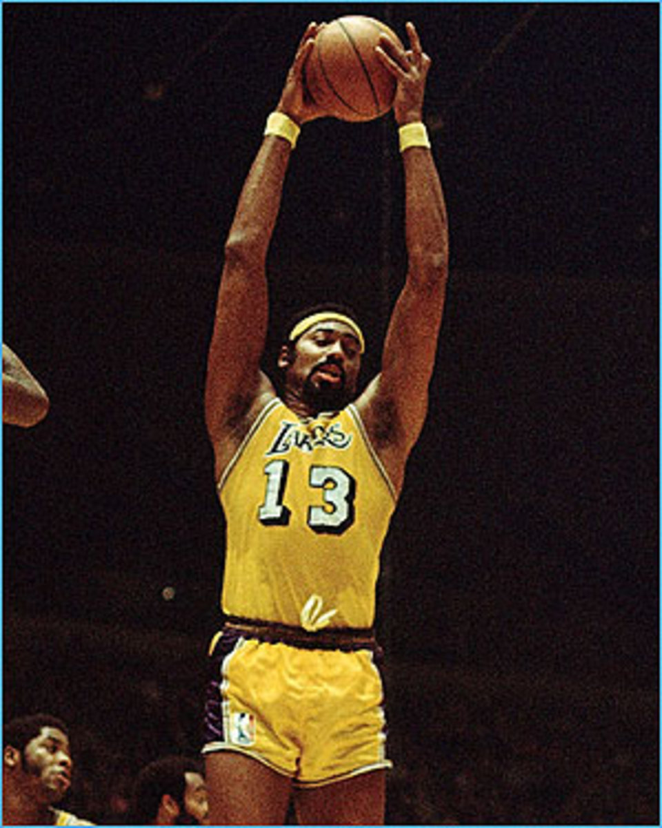 Wilt pulls down one of his 22.9 rebounds per game!