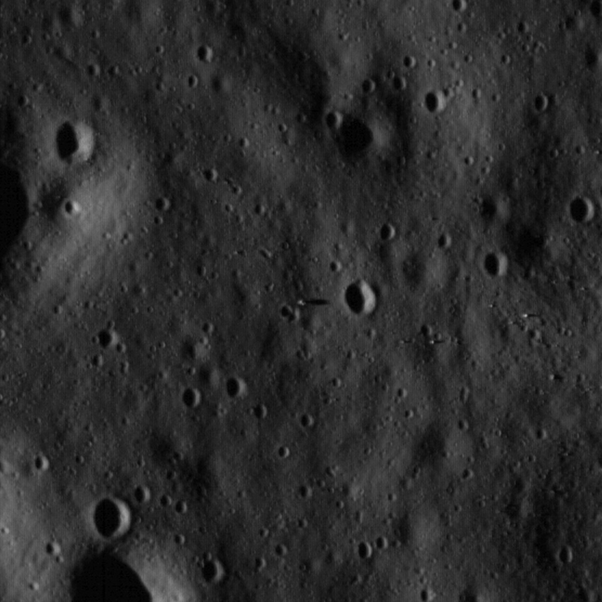 July 2009. Zooming in on last photo so you can see the lander and its shadow (extending to right) in exact center of image.