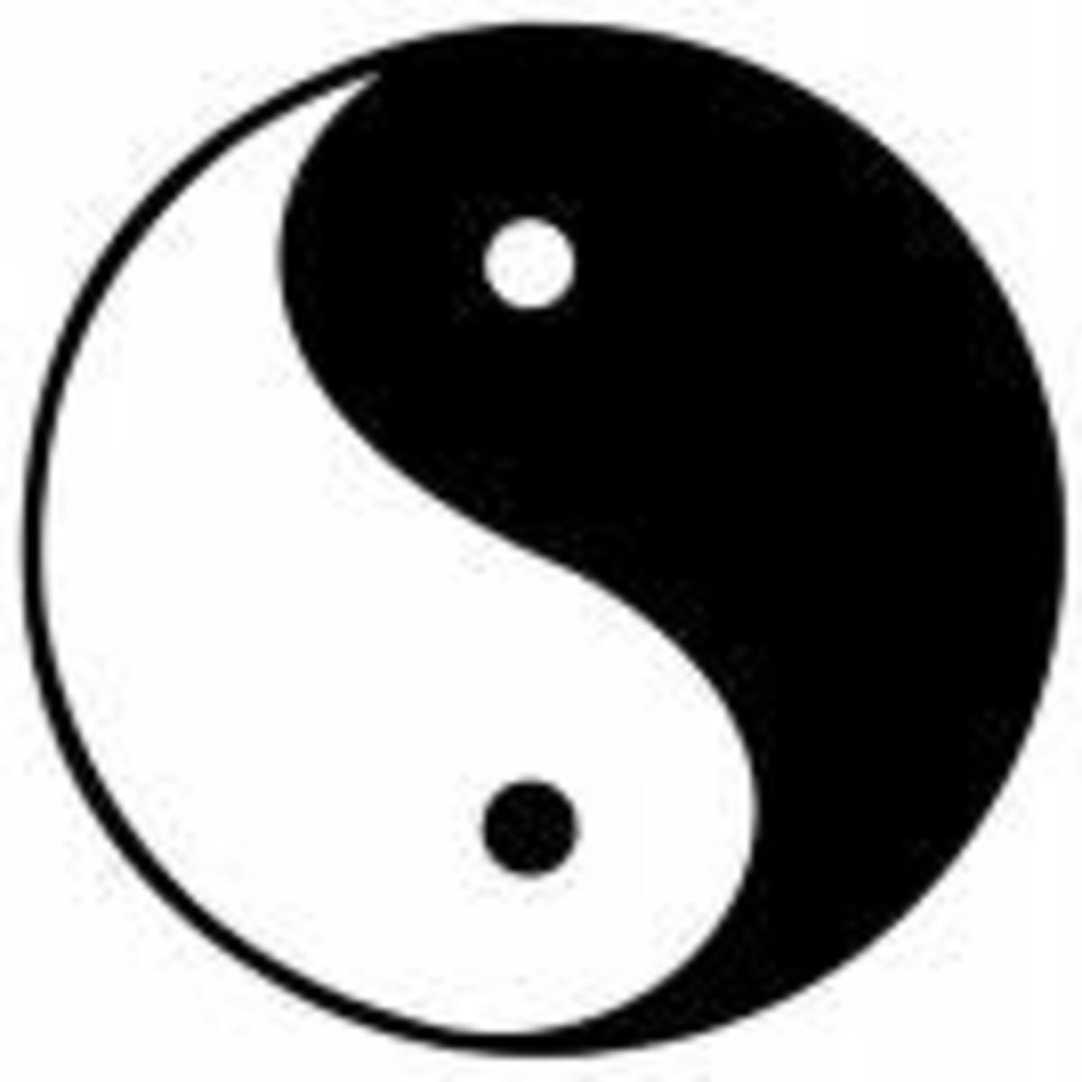 This is the traditional symbol for the opposing, yet complimentary forces of yin and yang, sometimes described as 2 fishes swimming head to tail.