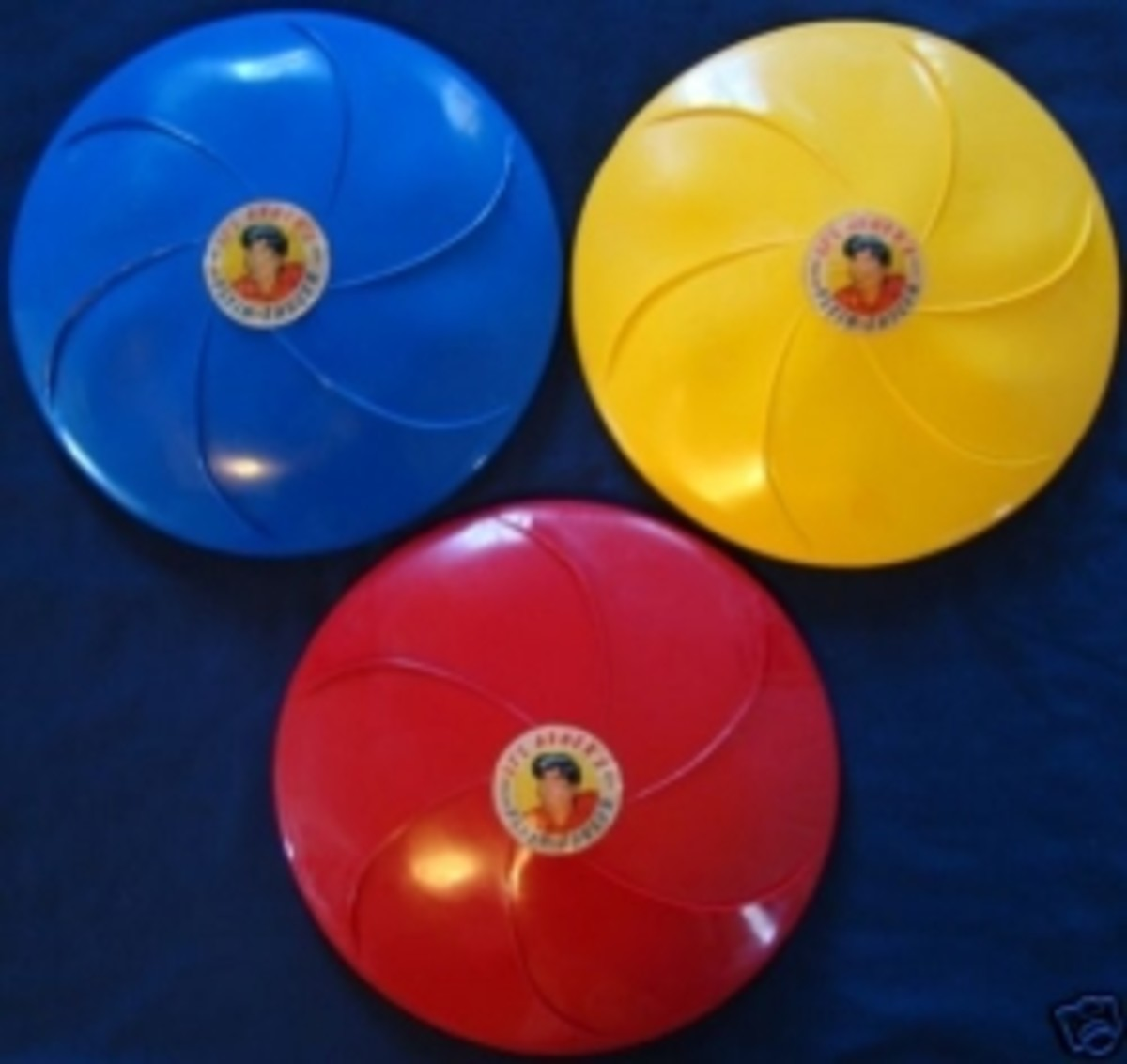 Rare Li'l Abner Flyin-Saucer Frisbees from the 1950s.