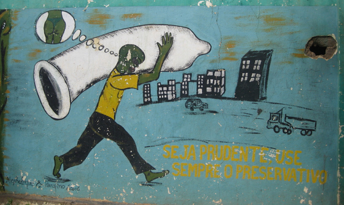 "AIDS awareness painting on wall in Chimoio town, Mozambique. The text reads: ""be carefull, always use a condom"""