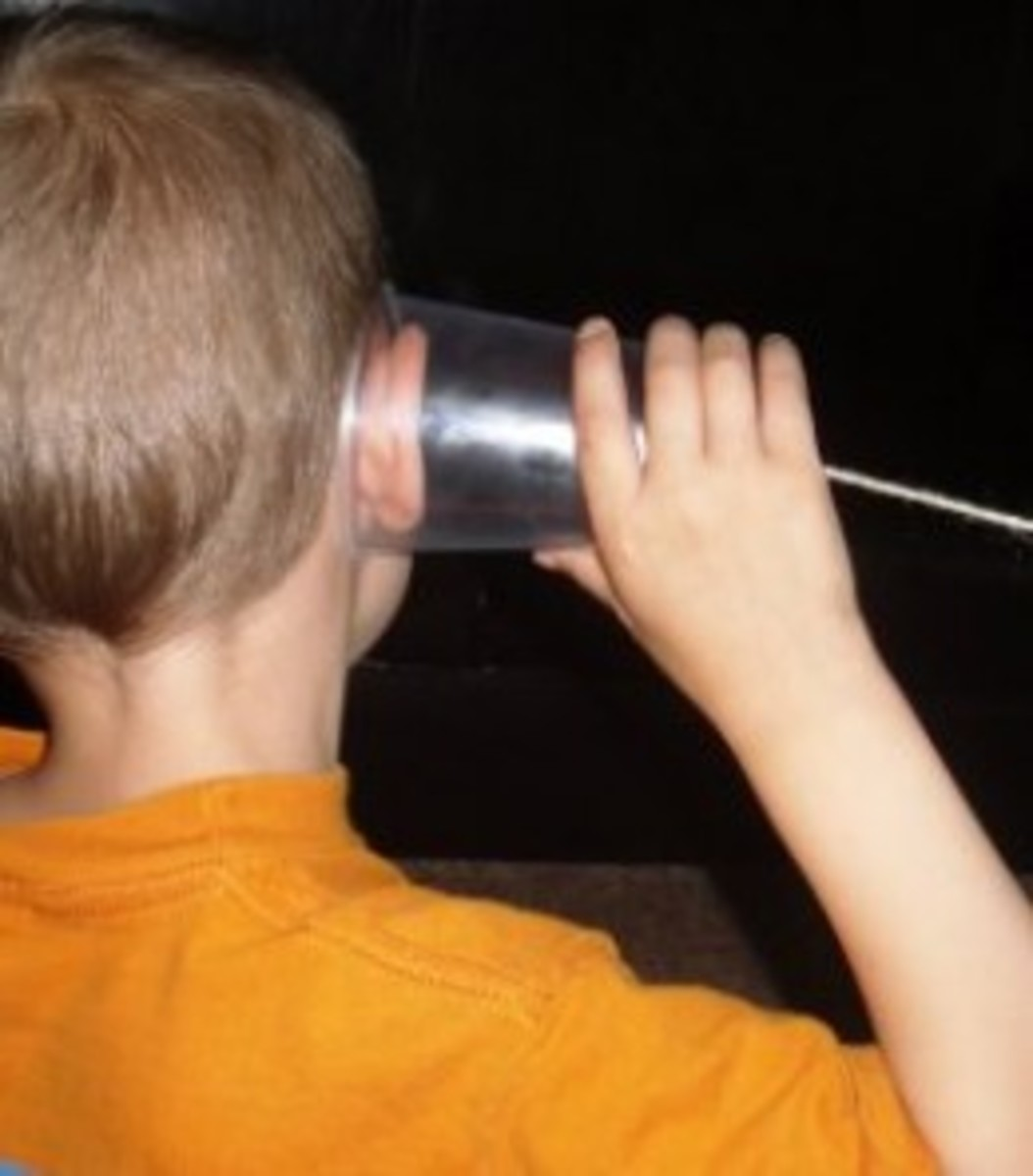 Using cup phones to learn how sound waves travel during the first lesson in this unit study on hearing and sound waves