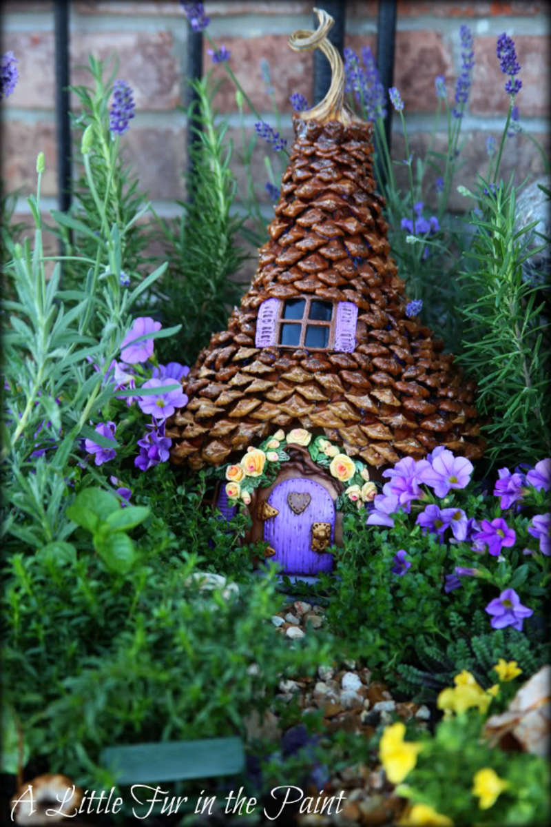 Fairy house made from gourds and pinecone.  To make this house, visit http://alittlefurinthepaint.blogspot.com/2012/12/the-fairy-house-revisited.html