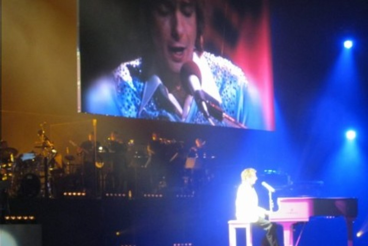 "A very cool part of the show where he sings a duet with himself (on the large screen) the spotlight was so bright, he looks almost ""angelic"" in this picture."