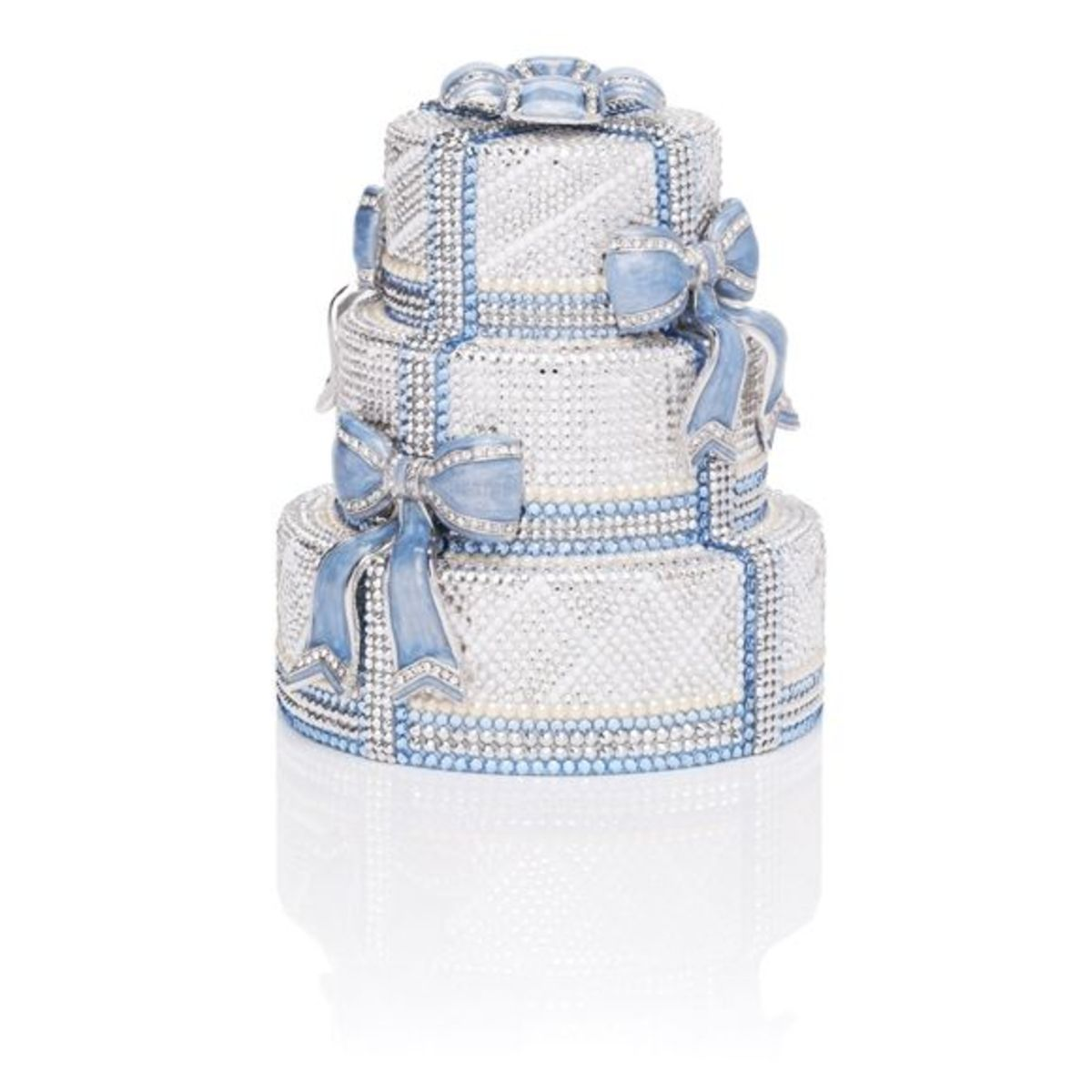 """BLUE BOWSPrice: $6,995Limited edition, triple tiered wedding cake minaudière with enamel bow accents, top snap closure and 19"""" chain. Perfect bag for your bedding day!"""