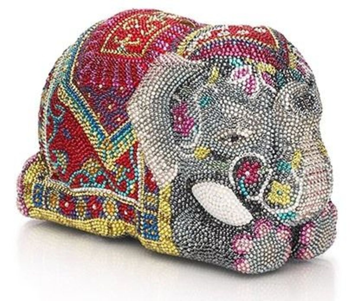 MAHARAJA Price: $5,995This brightly colored elephant is a must have as it has ornate costuming details, sculpted ears, tusks, feet and trunk. It also includes onyx eyes. It includes a tuck away chain. Inspired by the elephants that Indian Maharaja