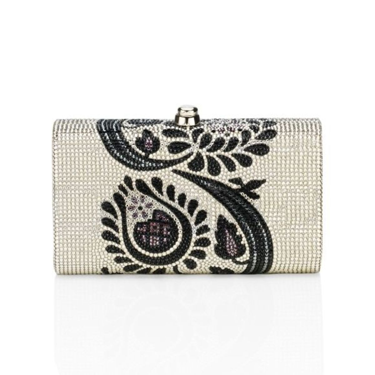 """FIELD FLOWERSPrice: $2,995Curved minaudière featuring a dynamic silhouetted floral design against a field of silver. 19"""" chain."""
