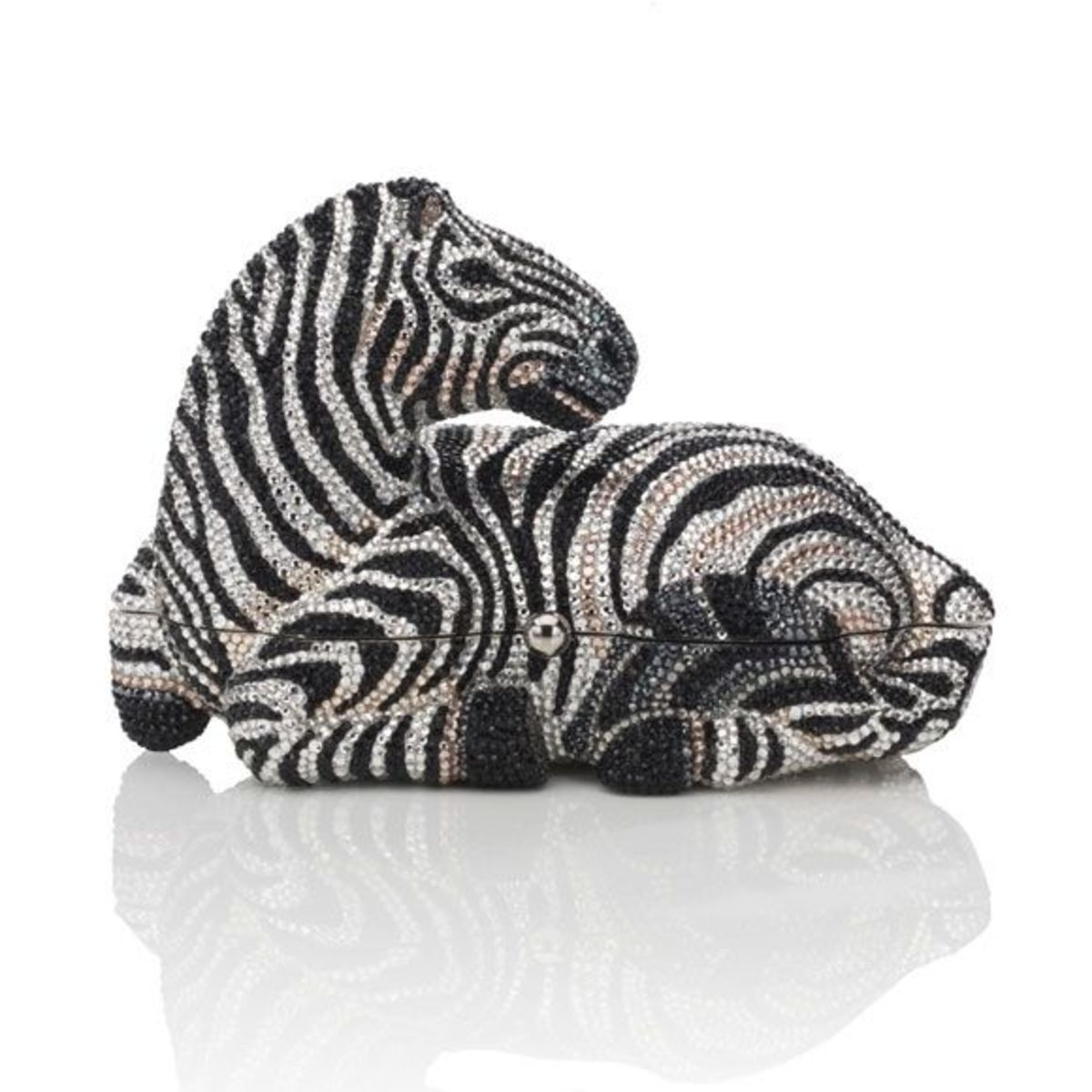 """BOTSWANAPrice: $4,995Hand beaded crystal minaudière featuring a traditional zebra pattern and onyx eye detailing. Side snap closure and 19"""" chain."""