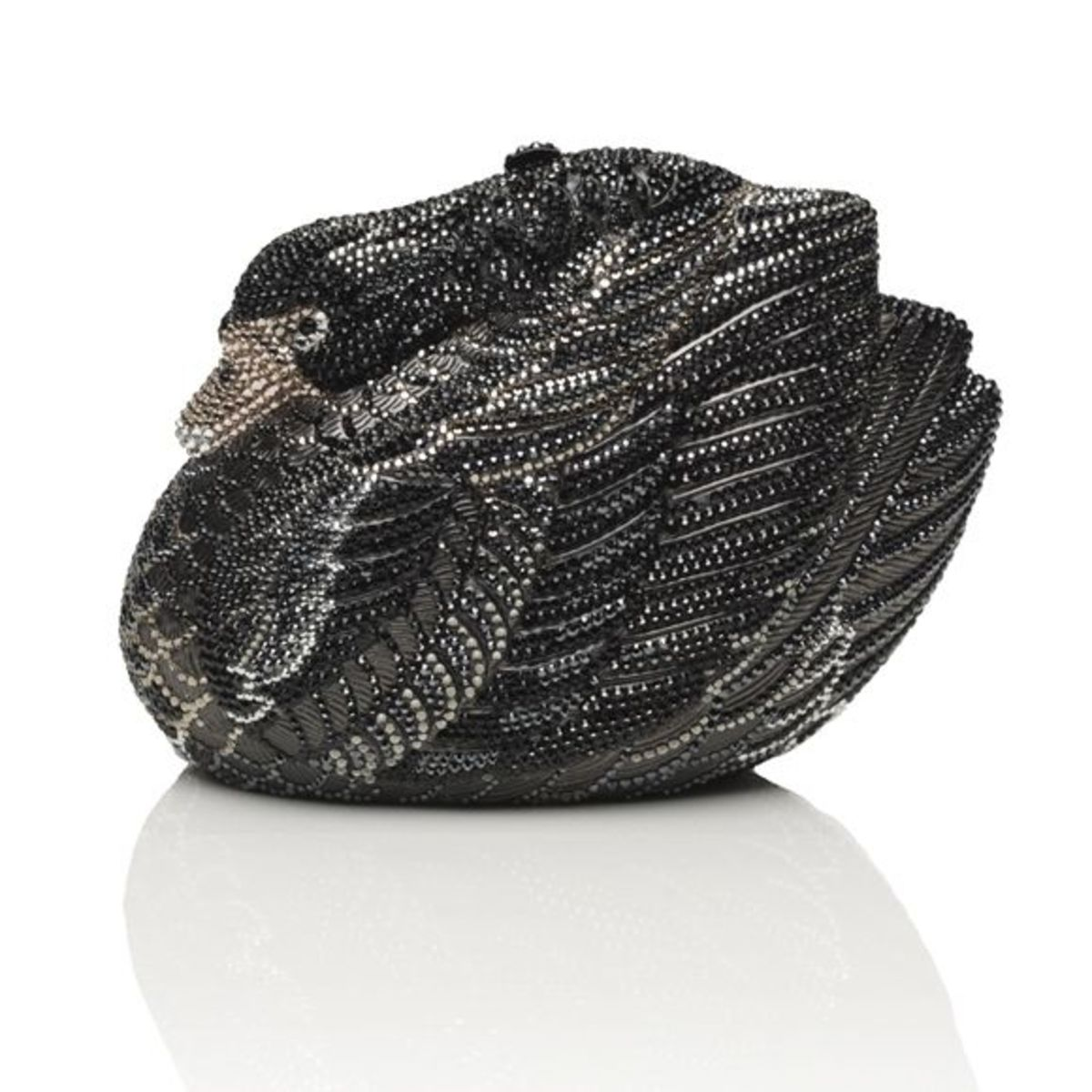 """ODILEPrice: $4,295Swan minaudière with feathers defined in deep toned crystal with blush accents. Top snap closure, 19"""" chain. Graceful and elegant."""