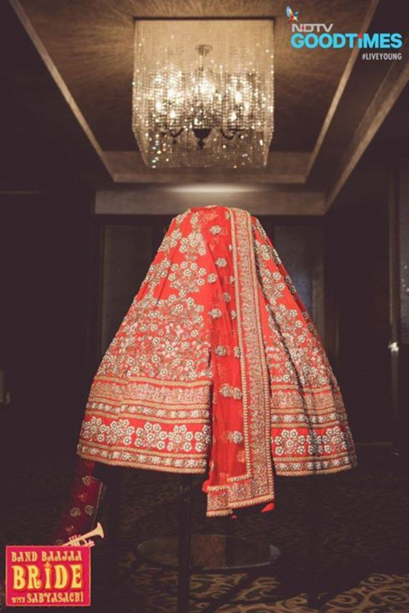 Photograph of Wedding lehenga skirt an dupatta in red and gold