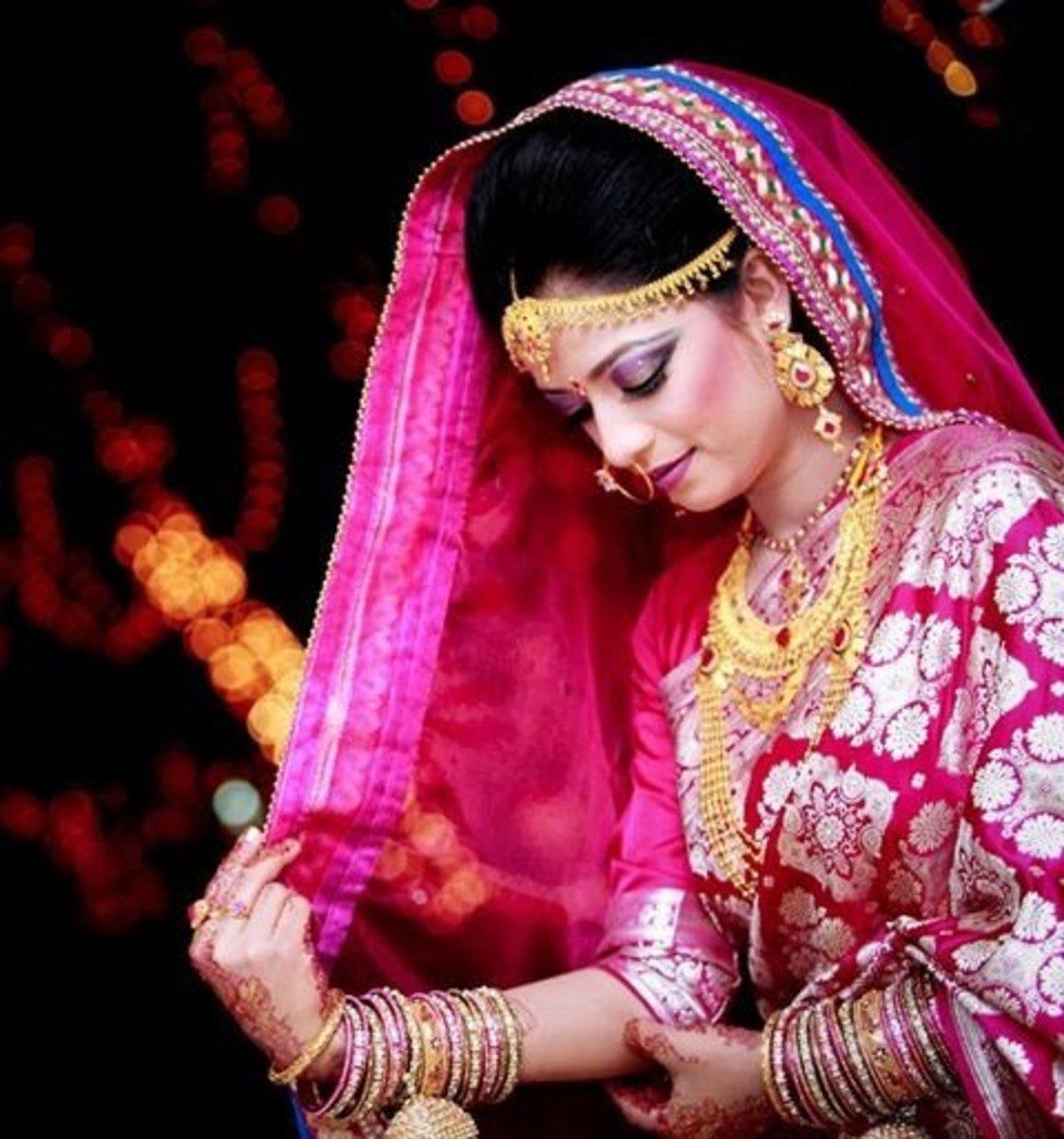 Magenta Bridal Katan Saree. Gorgeous Bangladeshi Bride wearing Hot pink / Magenta wedding katan saree.