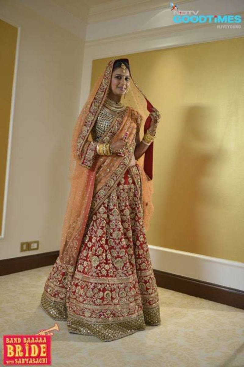 Exclusive Bridal lehenga in Red and Orange. Sabyasachi Lehenga