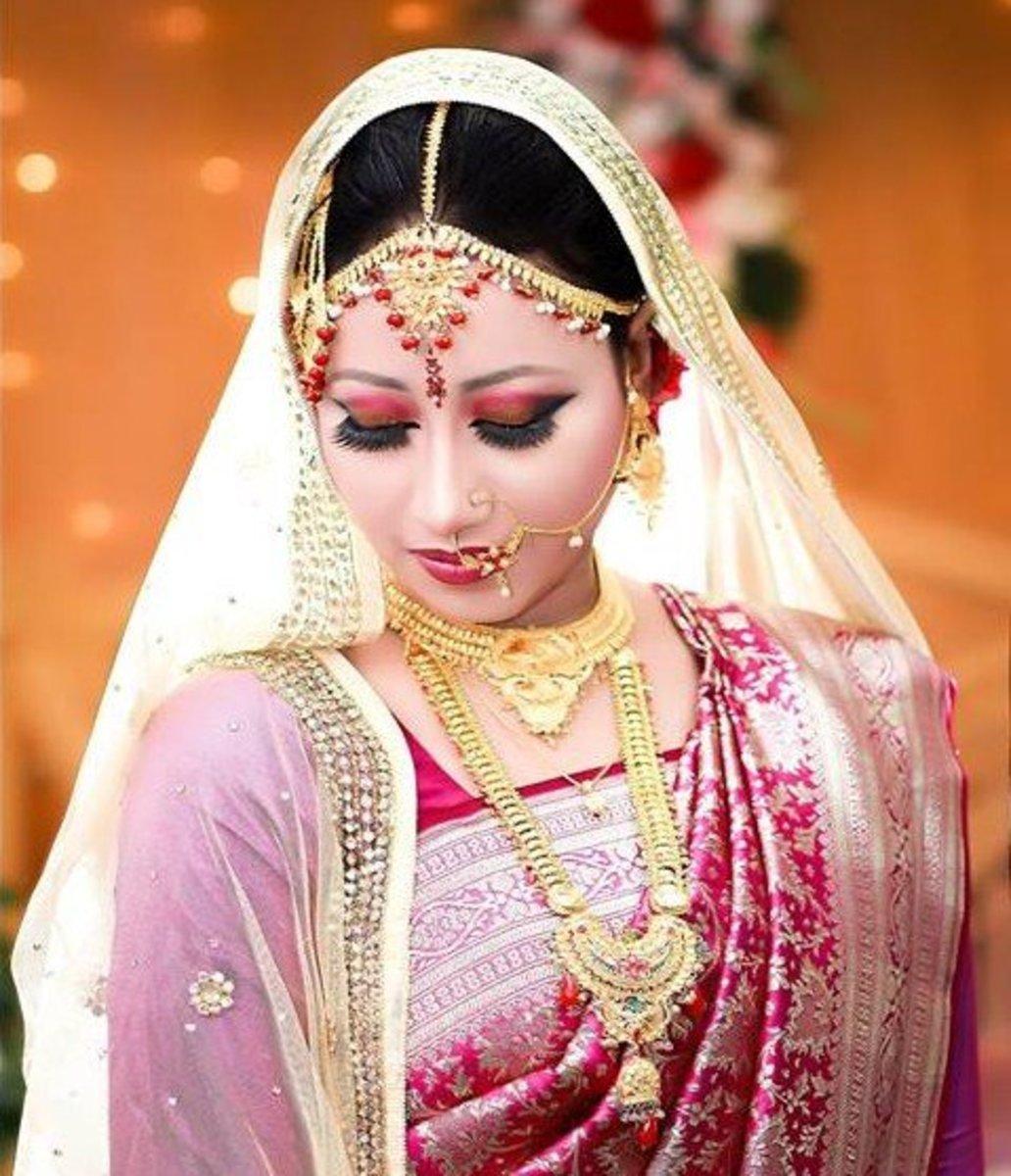 Magenta-Red Bridal Katan saree.